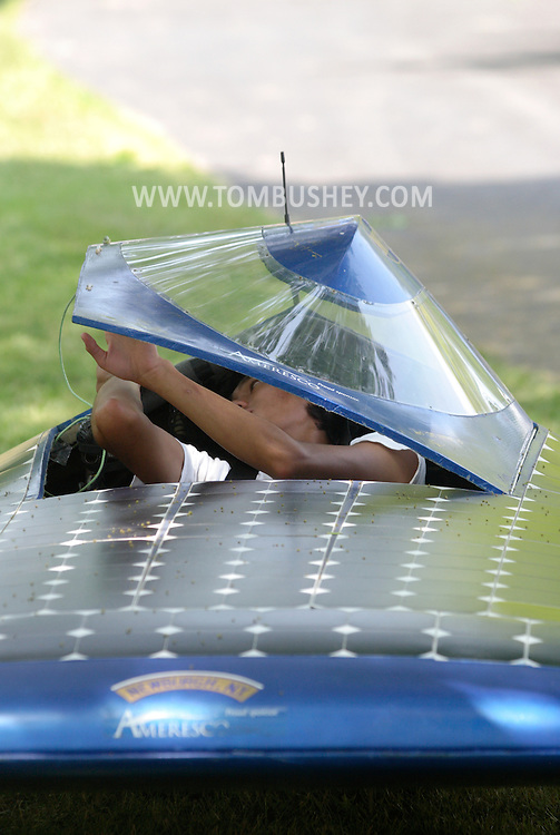 A Newburgh Free Academy student closes the cockpit of a solar car, which was on display at the Orange County Earth and Water Festival sponsored by Orange County, Orange Environment and the Orange County Water Authority on June 7, 2008. The car is powered by 470 solar panels.