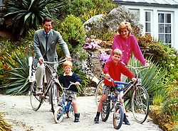File photo dated 01/06/89 of the Prince and Princess of Wales with sons Prince William, right, and Prince Harry preparing for a cycling trip in Tresco during their holiday on the Scilly Isles.