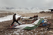 "A yurt has been blown away overnight because of the extreme Pamir wind known as ""Bad-e Pamir""..In camp of Ech Keli (er Ali Boi's camp)...Trekking through the high altitude plateau of the Little Pamir mountains, where the Afghan Kyrgyz community live all year, on the borders of China, Tajikistan and Pakistan."