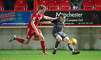 Lincoln City's Adam Crookes crosses the ball despite the attentions of Accrington Stanley's Matthew Platt<br /> <br /> Photographer Andrew Vaughan/CameraSport<br /> <br /> The EFL Checkatrade Trophy Second Round - Accrington Stanley v Lincoln City - Crown Ground - Accrington<br />  <br /> World Copyright © 2018 CameraSport. All rights reserved. 43 Linden Ave. Countesthorpe. Leicester. England. LE8 5PG - Tel: +44 (0) 116 277 4147 - admin@camerasport.com - www.camerasport.com