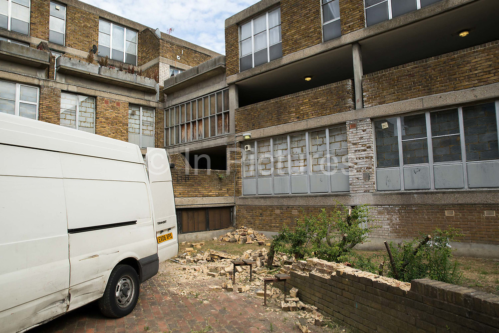 Brick removal during the regeneration of Thrayle House in Lambeth on 29th July 2015 in South London, United Kingdom.