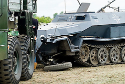 """The World War Two German Sd.Kfz 251 Halftrack that appeared in the new AA advert had to be towed away when one of its front wheels fell off in front of a packed audience at the """"Yorkshire Wartime Experience"""" on Sunday Afternoon (5 June 2015)  one of the North's largest reenactment and military vehicle events <br />  05 July 2015<br />  Image © Paul David Drabble <br />  www.pauldaviddrabble.co.uk"""