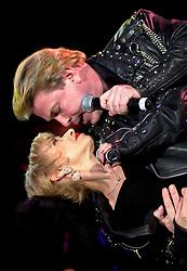 Pop Duo, Dollar on tour with<br /><br />Steve Starnge (Visage)<br />Claire Grogan (Altered Images)<br />The Belle Stars<br />Kim Wilde<br />The Human League<br />Play on the Here and Now  Christmas Party Tour at Sheffields Hallam FM Arena Friday 13th December 2002<br /><br />[#Beginning of Shooting Data Section]<br />Nikon D1 <br />2002/12/13 21:22:35.2<br />JPEG (8-bit) Fine<br />Image Size:  2000 x 1312<br />Color<br />Lens: 80-200mm f/2.8-2.8<br />Focal Length: 80mm<br />Exposure Mode: Manual<br />Metering Mode: Spot<br />1/200 sec - f/2.8<br />Exposure Comp.: 0 EV<br />Sensitivity: ISO 800<br />White Balance: Auto<br />AF Mode: AF-S<br />Tone Comp: Normal<br />Flash Sync Mode: Not Attached<br />Color Mode: <br />Hue Adjustment: <br />Sharpening: Normal<br />Noise Reduction: <br />Image Comment: <br />[#End of Shooting Data Section]