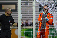 A linesman and Maidstone United goalkeeper Grant Smith (1) laugh  during the The FA Cup match between Maidstone United and Oldham Athletic at the Gallagher Stadium, Maidstone, United Kingdom on 1 December 2018. Photo by Martin Cole