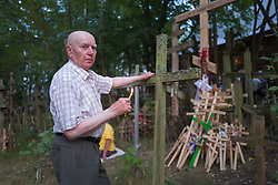 August 18, 2017 - Grabarka, Poland - An elderly man touches a cross. Some 15,000 Orthodox Christian pilgrims carried crosses, drank holy water and prayed on Grabarka Mount in eastern Poland. The Holy Hill of Grabarka, believed to have saved people from a cholera epidemic in the 18th century, is the most sacred Orthodox site in Poland. (Credit Image: © Velar Grant via ZUMA Wire)
