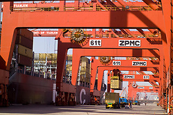 Tianjin, China,exporting, dock workers, Chinese, shipping, port, trucks, export, industrial, shipping containers, trucks