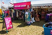 The Oxfam stall in the main arena. WOMAD 2014, festival of world music and dance, Charlton Park, Wiltshire. UK.