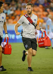 August 4, 2018 - Houston, TX, U.S. - HOUSTON, TX - AUGUST 04:  Sporting KC Director of Sports Medicine Kurt Andrews returns to the bench after examining an injured player during the soccer match between Sporting Kansas City and Houston Dynamo on August 4, 2018 at BBVA Compass Stadium in Houston, Texas.  (Photo by Leslie Plaza Johnson/Icon Sportswire) (Credit Image: © Leslie Plaza Johnson/Icon SMI via ZUMA Press)