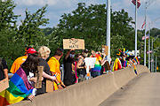 Participants in the Milton Pride Rally hold signs and pride flags on the bridge over the Susquehanna river in Milton, Pennsylvania on August 8, 2020. The I Am Alliance organized the event to show support for the LGBTQ community.