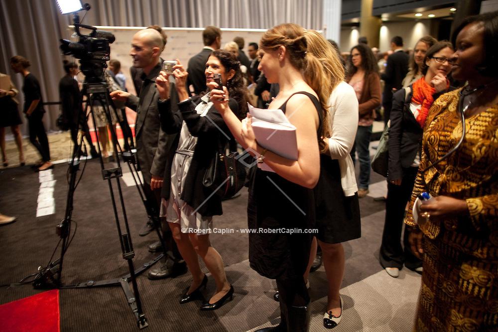 Karen Zuckerberg photographs her daughter Randi Zuckerberg at the UN Gala in New York where she interviewed attendees live on Facebook....Photo by Robert Caplin.