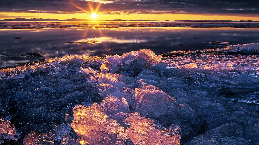 Spring break-up ice design, midnight light, June, Kotzebue, Alaska, USA
