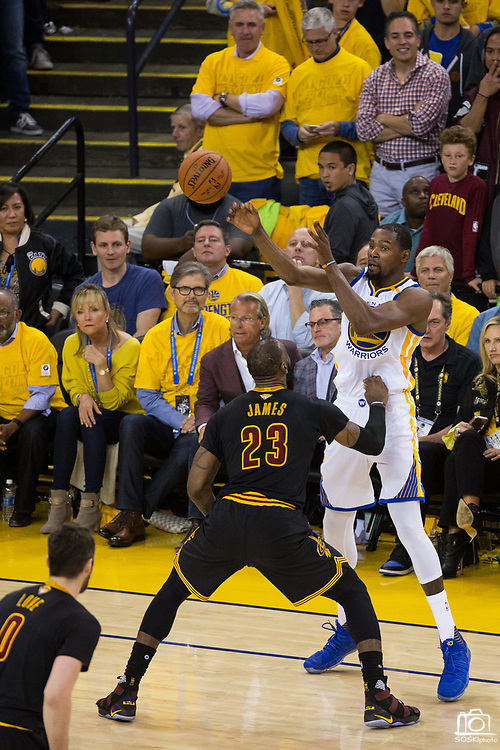 Golden State Warriors forward Kevin Durant (35) passes the ball over Cleveland Cavaliers forward LeBron James (23) during Game 5 of the NBA Finals at Oracle Arena in Oakland, Calif., on June 12, 2017. (Stan Olszewski/Special to S.F. Examiner)