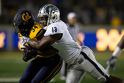 Nevada safety Jordan Lee (13) drags down California running back Christopher Brooks (34) during the first quarter of an NCAA college football game, Saturday, Sept. 4, 2021, in Berkeley, Calif. (AP Photo/D. Ross Cameron)