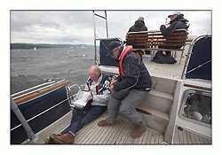 470 Class European Championships Largs - Day 3.Brighter conditions with more wind...Finish Boat crew.