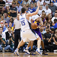 14 June 2009: Kobe Bryant of the Los Angeles Lakers passes around Hedo Turkoglu of the Orlando Magic during game 5 of the 2009 NBA Finals won 99-86 by the Los Angeles Lakers over the Orlando Magic at Amway Arena, in Orlando, Florida, USA. Kobe Bryant scores 30 points and leads the Lakers to15th Championship.