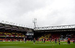 A general view of Watford players warming up at Vicarage Road ahead of the match