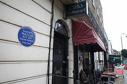 London, UK. 5th August, 2021. A blue plaque bearing Giuseppe Mazzini's name is pictured alongside Speedy's Sandwich Bar and Cafe. The ceramic plaque was installed in honour of the Italian patriot by London County Council in 1950.