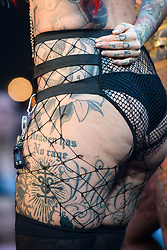 Visitors with tattoos at the London Tattoo Convention, held at Tobacco Dock in east London. Picture date: Friday September 22nd, 2017. Photo credit should read: Matt Crossick/ EMPICS Entertainment.