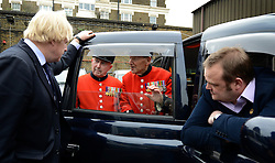 © Licensed to London News Pictures. 02/05/2012. London, UK London Mayor,Boris Johnson(L) is joined bycomedian Al Murray(sitting) to wave off an army ofWWII veterans who are embarking on an iconic trip to the Netherlands, via a convoy of black cabs.The London Taxi Benevolent Association for the War Disabled has organised a trip for 160 WWII veterans to travel to Holland in 80 London Black Cabs. The veterans, mostly aged between 85 and 94, will start their journey from London today 2nd May 2012 and will be visiting sites of importance from WWII and taking part in Dutch Liberation Day celebrations as guests of honour of the Dutch Royal Family.. Photo credit : Stephen Simpson/LNP