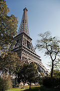 The iconic Eiffel Tower seen from the Champ de Mars gardens in Paris, France