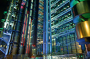 "At night we see the floodlit exterior of British architect Sir Richard Rogers' Lloyds building, home to the post-modern architecture of the insurance underwriters insurance institution Lloyd's of London which is located at number 1, Lime Street, in the heart of the City of London. Lloyd's is a British insurance market. It serves as a meeting place where multiple financial backers or ""members"", whether individuals (traditionally known as ""Names"") or corporations, come together to pool and spread risk. Unlike most of its competitors in the reinsurance market and is neither a company nor a corporation. The Lloyds market began in Edward Lloyd's coffeehouse around 1688 and is today the world's leading insurance market providing specialist insurance services to businesses in over 200 countries and territories."
