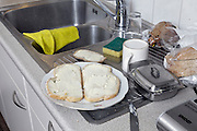 bread with butter and cup on kitchen counter