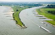 Nederland, Gelderland, Gemeente Lingewaard, 28-06-2006; luchtfoto (25% toeslag de Pannerdensche Kop gezien in Noordwestelijke richting, de Rijn splist zich in Waal (links) en Pannerdensch Kanaal (rechts, overgaand in Neder-Rijn het voormalig Fort Pannerden ligt ongeveer halverwege deze landtong (net voor de twee waterplassen, zie ook andere detailfoto's de strekdammen (of kribben) in rivier en kanaal zorgen voor goede bevaarbaarheid; navigatie, kanalisatie, waterbeheer, binnennvaart, beroepsvaart, rijnaak, binnenvaart, verkeer en vervoer, scheepvaart.luchtfoto (toeslag aerial photo (additional fee required .foto Siebe Swart / photo Siebe Swart