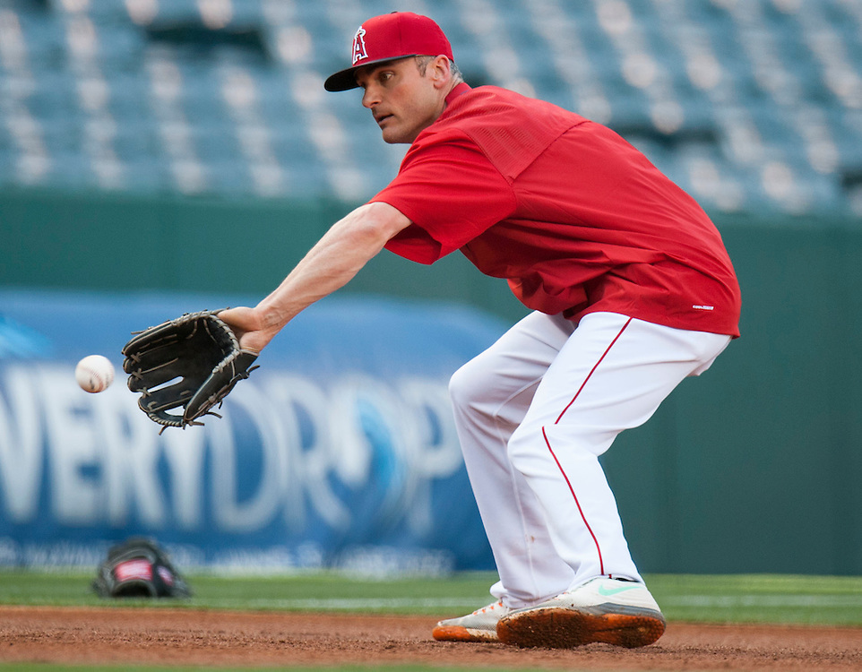 Brendan Ryan takes grounders on his first day as an Angel before their game against the St. Louis Cardinals Tuesday at Angel Stadium.<br /> <br /> ///ADDITIONAL INFO:   <br /> <br /> angels.0511.kjs  ---  Photo by KEVIN SULLIVAN / Orange County Register  --  5/10/16<br /> <br /> The Los Angeles Angels take on the St. Louis Cardinals at Angel Stadium Tuesday.<br /> <br />  5/10/16