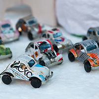"VENICE, ITALY - DECEMBER 18:  A selection of car models made from recycled cans in Madagascar for sale at ""l'Altro Natale"" Christmas market on December 18, 2010 in Venice, Italy. ""L'Altro Natale"" an alternative Christmas market organised over the busiest shopping week end of the year promotes fair trade and alternative commerce."