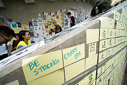 Pro-democracy Lennon Walls being created at Tamar Government offices in Hong Kong. Posters, notes and artwork is stuck to walls and ground.