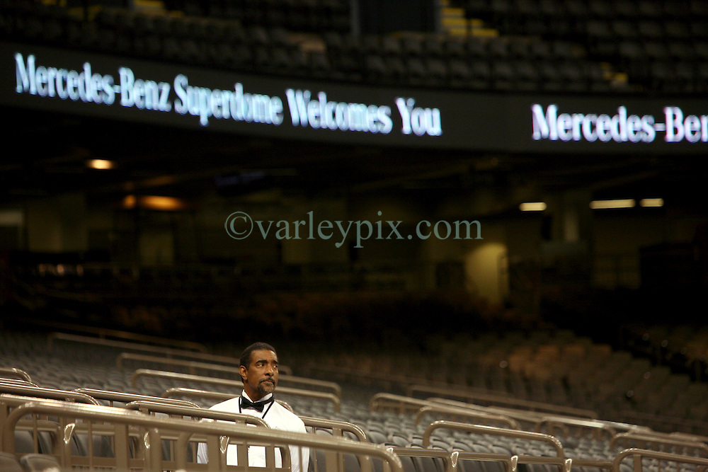 04 October 2011. New Orleans, Louisiana, USA.  <br /> NFL's New Orleans Saints announce a multi million dollar deal with Mercedes-Benz for naming rights on the Louisiana Superdome. Now the Mercedes-Benz Superdome. A waiter looks on from the bleachers.<br /> Photos; Charlie Varley/varleypix.com