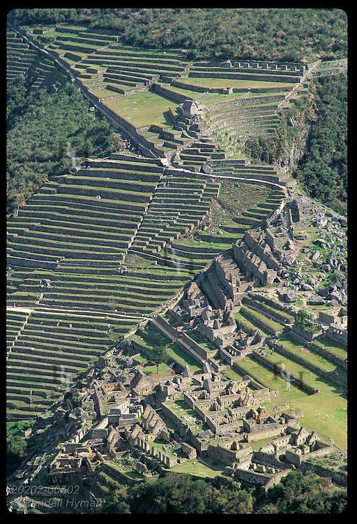 Agriculturl terraces, both urban sectors & barracks show in view from Huayna Picchu; Machu Picchu Peru