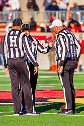 NORMAL, IL - October 16:  John Powell, Matt Winter, Referee Aaron Adams during a college football game between the NDSU (North Dakota State) Bison and the ISU (Illinois State University) Redbirds on October 16 2021 at Hancock Stadium in Normal, IL. (Photo by Alan Look)