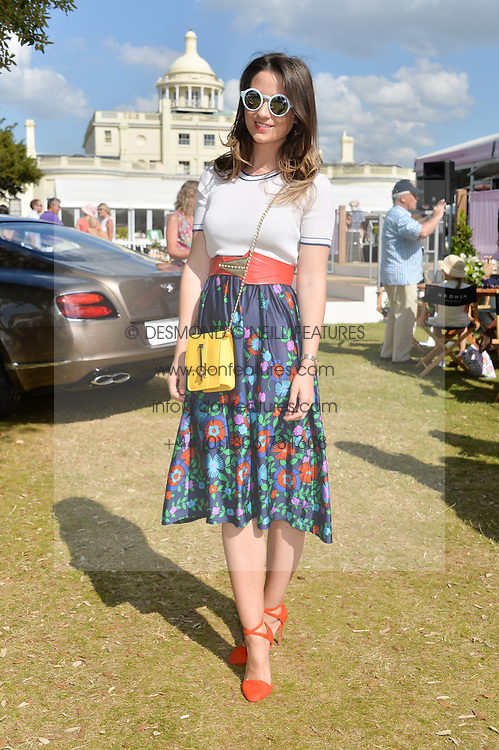 KELLY EASTWOOD at the Summer Solstice Party during the Boodles Tennis event hosted by Beulah London and Taylor Morris at Stoke Park, Park Road, Stoke Poges, Buckinghamshire on 21st June 2014.