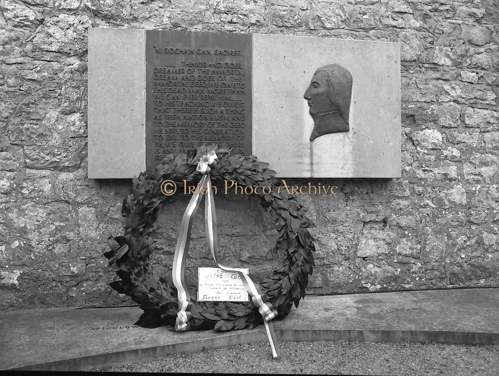"""Annual Wolfe Tone Commemoration.  (R65)..1987..11.10.1987..10.11.1987..11th October 1987..The annual Fianna Fáil Wolfe Tone commemoration was held at Bodenstown today, the keynote oration was given by An Taoiseach, Charles Haughey TD...Pictured is the wreath laid by Fianna Fail at the memorial to Wolfe Tone..""""Ní siochan gan saoirse"""" (There is no peace without freedom) the opening line on the memorial to Theobald Wolfe Tone."""