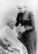 Elizabeth Cady Stanton, seated, and Susan B. Anthony, standing, three-quarter length portrait 1900.