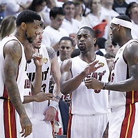 21 June 2012: Miami Heat shooting guard Dwyane Wade (3) talks to Miami Heat point guard Norris Cole (30), Miami Heat shooting guard Mike Miller (13), Miami Heat power forward Udonis Haslem (40) and Miami Heat small forward LeBron James (6) during the Miami Heat 121-106 victory over the Oklahoma City Thunder, in Game 5 of the 2012 NBA Finals, at the AmericanAirlinesArena, Miami, Florida, USA. The Miami Heat wins the series 4-1.