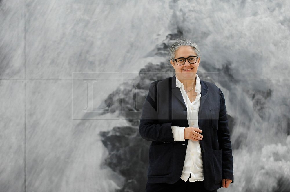 "© Licensed to London News Pictures. 14/05/2018. LONDON, UK. Tacita Dean, artist, poses with her work ""The Montafon Letter"", 2017, in the new Gabrielle Jungels-Winkler Galleries at a photocall for the opening of the new Royal Academy of Arts (RA) in Piccadilly.  As part of the celebrations for its 250th anniversary year, redevelopment has seen the RA's two buildings, 6 Burlington Gardens and Burlington House, united into one extended campus and art space extending from Piccadilly to Mayfair.  Photo credit: Stephen Chung/LNP"