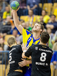 Povilas Babarskas of RK Celje PL vs Niko Medved of RK Gorenje and Senjamin Buric of RK Gorenje during handball match between RK Celje Pivovarna Lasko and RK Gorenje Velenje in Eighth Final Round of Slovenian Cup 2015/16, on December 10, 2015 in Arena Zlatorog, Celje, Slovenia. Photo by Vid Ponikvar / Sportida