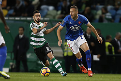 December 1, 2017 - Lisbon, Portugal - Sporting's midfielder Bruno Fernandes (L) vies for the ball with Belenenses's midfielder Hassan Yebda (R)  during Primeira Liga 2017/18 match between Sporting CP vs CF Belenenses, in Lisbon, on December 1, 2017. (Credit Image: © Carlos Palma/NurPhoto via ZUMA Press)
