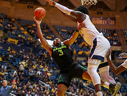 Jan 21, 2019; Morgantown, WV, USA; West Virginia Mountaineers forward Andrew Gordon (12) blocks a shot from Baylor Bears guard King McClure (3) during the first half at WVU Coliseum. Mandatory Credit: Ben Queen-USA TODAY Sports