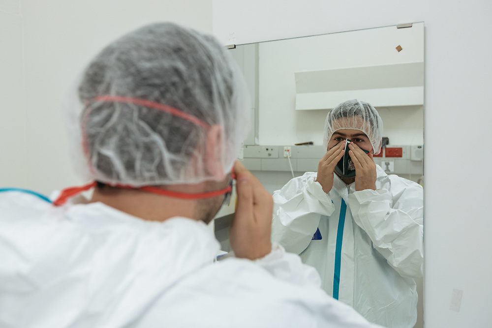 Dr. Fadi Kharouf puts on protective gear as he prepares to enter an isolated ward to treat Covid-19 Novel Coronavirus patients, at the Hadassah Ein Kerem Hospital, in Jerusalem, Israel, on April 20, 2020.