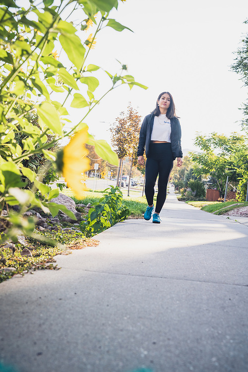 Marina Inoue walking in the 9th and 9th area of Salt Lake City, Utah.