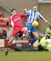 Photo: Leigh Quinnell.<br /> Swindon Town v Chester City. Coca Cola League 2. 24/02/2007. Swindons Lukas Jutkiewicz clashes with Chesters Paul Linwood.