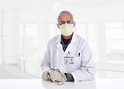 Medical Professional Wearing a Surgical Mask and Gloves