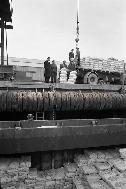 """1/02/1963<br /> 02/11/1963<br /> 11 February 1963<br /> Nitra-Shell 23 cargo discharged at New Ross, Co. Wexford. The """"M.V. Roelf Buisman"""" from Rotterdam on it's first visit to New Ross delivering 500 ton of Nitra -Shell 23 the first consignment of 23% Nitrogen imported into Ireland. Messrs. Albatross Windmill Fertiliser Co. Ltd. were the importers. Picture shows Mr. E.F. Storey, Managing Director, Albatross Windmill Fertiliser Co. Ltd. (right), looking at some of the Nitra-Shell 23 along with (l-r): Mr. M. Murphy, Manager J.J. Stafford (New Ross); Captain  Smith of the """"Roelf Buisman"""" and Mr. J.J. Boyle, General Manager of Shell and Albatross (Agricultural) Ltd."""