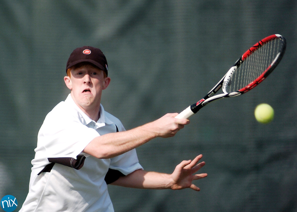 Concord High School's Justin Wycoff returns a ball against A.L. Brown's Kyle Moore Monday afternoon at Les Myers Park.