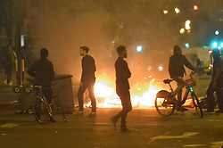 """July 28, 2017 - London, London, UK - London, UK. Protester take to the streets of Dalston and clash with police following the death of Rashan Charles whilst being arrested by police.  A statement from Scotland Yard said Mr Charles went into a shop, where he was seen """"trying to swallow an object"""" and it was then police officers struggled with him to make an arrest. (Credit Image: © Ray Tang/London News Pictures via ZUMA Wire)"""