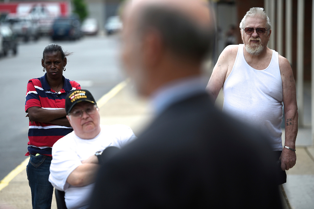 A trio of supporters listen to Pennsylvania Democratic gubernatorial candidate Tom Wolfe outside a Williamsport, PA diner on May 14, 2014.