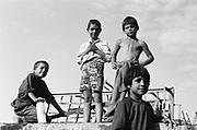 Mihaela Capra (deuxième en partant de la gauche) à 7 ans en 1993 dans la cour de l'orphelinat de Popricani. Mihaela a été abandonnée à la naissance. <br /> <br /> Mihaela Capra (second from left) at 7 at Popricani's orphanage in 1993. Mihaela was abandoned at birth.